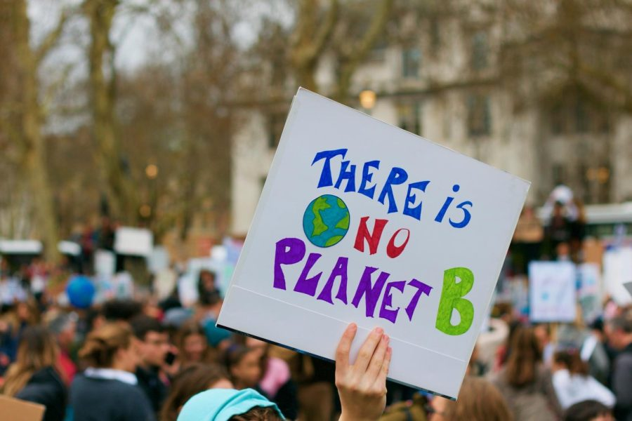 A person holds up a sign saying There is No Planet B at a climate change protest. Columnist Caroline Tadla argues that one persons effort to reduce climate change is not enough to make an impact.