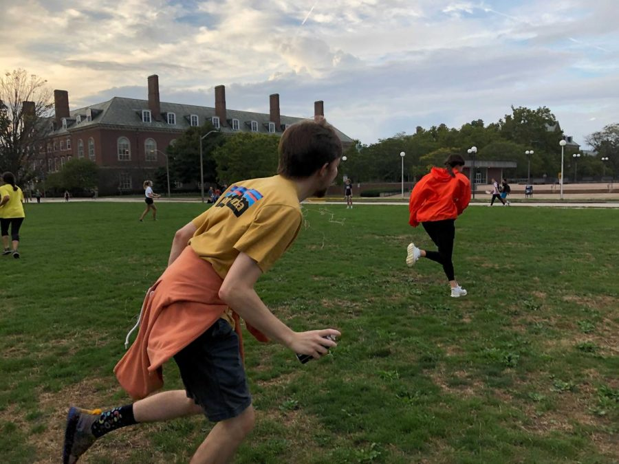 Students run around on the South Quad spraying silly string as they play capture the flag on Wednesday. This was one of many activities students could participate in for homecoming week.